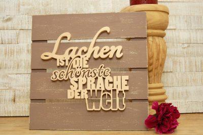 Lachen ist die schönste Sprache der Welt – Schriftzug-Deko